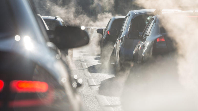 Cars idling in visible emissions