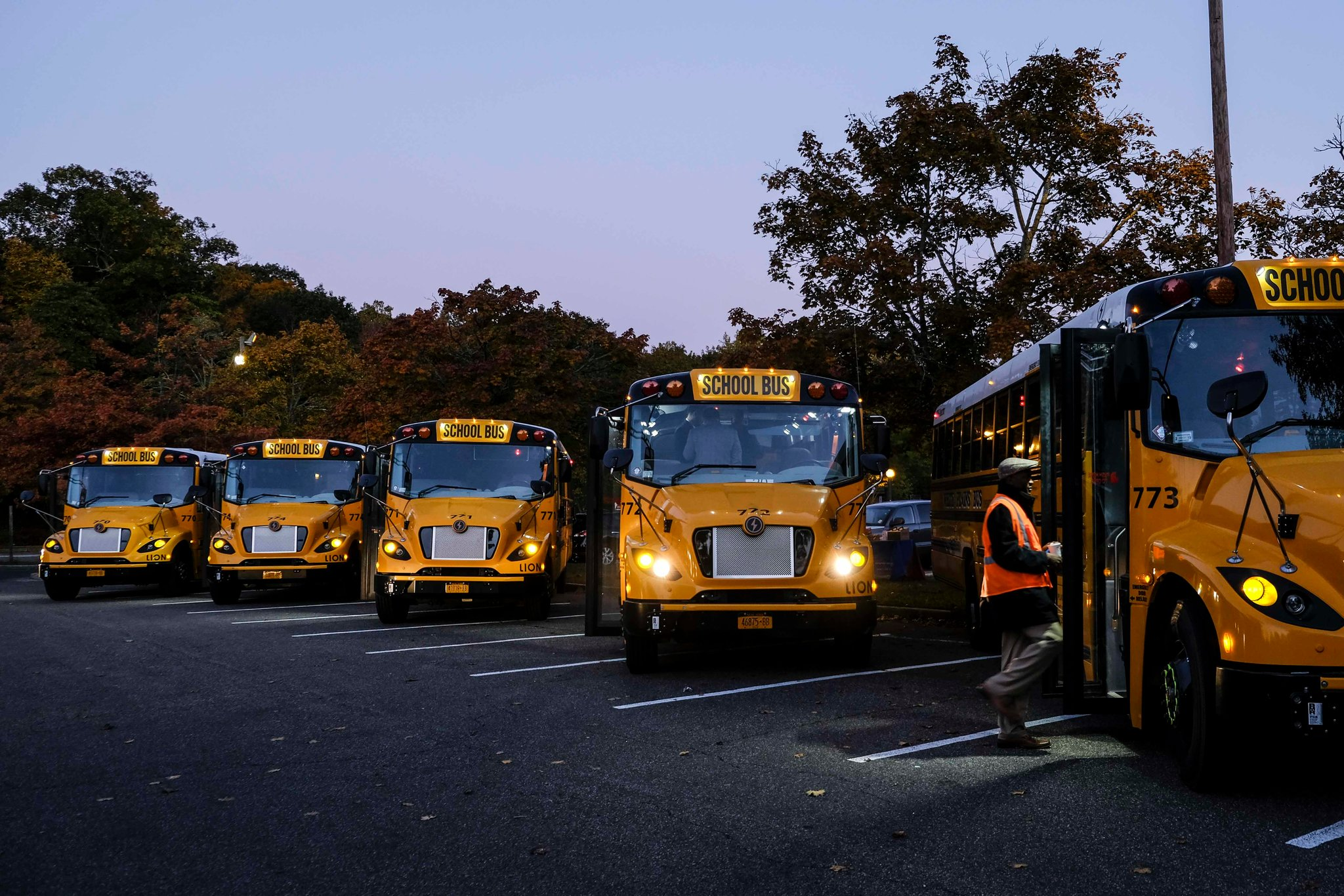 Electric buses in White Plains, N.Y. The school district's pilot program relies on a state grant and a partnership with the local electric utility. (Photo Credit: Byron Smith)